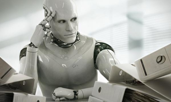 A robot sitting at a desk